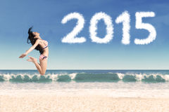 Attractive woman celebrate new year on beach Stock Image