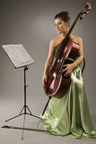 Attractive woman with cello Royalty Free Stock Photography