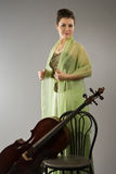 Attractive woman with cello Stock Images