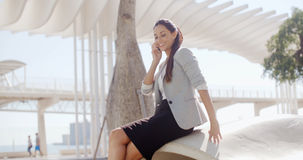 Attractive woman chatting on her mobile outdoors Stock Photography