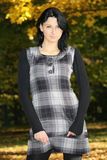 Attractive woman in checkered dress Stock Images