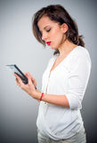Attractive woman checking her mobile phone Stock Photo