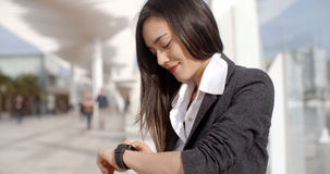 Attractive woman checking the time Royalty Free Stock Photo