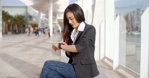 Attractive woman checking the time Stock Photos