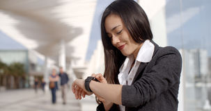 Attractive woman checking the time Stock Image
