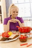 Attractive woman with cheese fondue royalty free stock photography