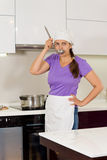 Attractive woman chef standing tasting the food Royalty Free Stock Photo