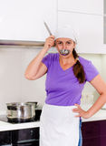 Attractive woman chef standing tasting the food Stock Photography
