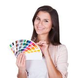 Attractive woman chooses a color scheme Stock Image