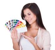 Attractive woman chooses a color scheme Stock Photos