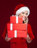 Attractive woman in Christmas cap Royalty Free Stock Images