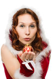 Attractive woman in a Christmas dress sends a kiss Royalty Free Stock Images