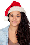 Attractive woman with Christmas hat Stock Photography