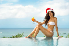 Attractive woman with Christmas hat Stock Image