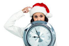Attractive woman with christmas hat holding clock Stock Photo