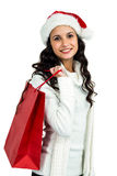 Attractive woman with christmas hat holding red shopping bag Stock Image