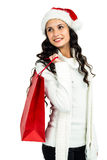 Attractive woman with christmas hat holding red shopping bag Stock Images