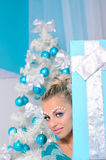 Attractive woman in christmas interior royalty free stock photo