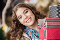 Attractive Woman With Christmas Presents In Store Royalty Free Stock Image