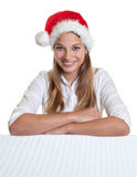 Attractive woman with christmas on a signboard Stock Photo