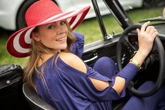 Attractive woman in classic car Stock Photos