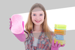 Attractive woman cleaning glass with pink sponge Royalty Free Stock Photo
