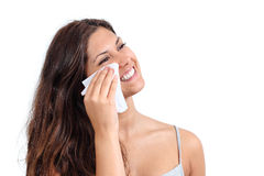 Attractive woman cleaning her face with a tissue Royalty Free Stock Photos