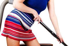 Attractive woman cleaning a room royalty free stock image