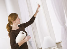 Attractive woman cleaning window Royalty Free Stock Photo
