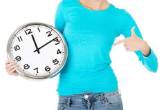 Attractive woman with a clock. Close up. Bodypart. Stock Images