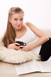 Attractive woman with a coffee cup lying on a sofa Royalty Free Stock Photo