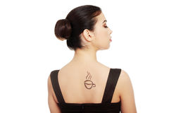 Attractive woman with coffee cup painted on her back. Stock Photos