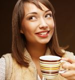 Attractive woman with coffee and dessert Stock Photography