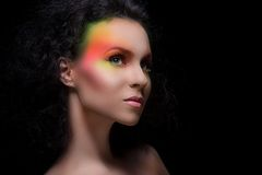 Attractive woman with colored make-up Royalty Free Stock Photography