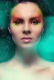 Attractive woman with colored make-up Royalty Free Stock Photos