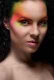 Attractive woman with colored make-up Royalty Free Stock Images