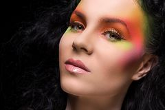 Attractive woman with colored make-up Royalty Free Stock Image