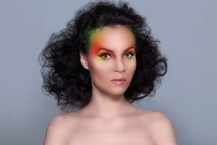 Attractive woman with colored make-up Stock Photo