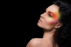 Attractive woman with colored make-up Stock Image