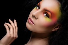 Attractive woman with colored make-up Stock Photography