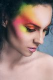 Attractive woman with colored make-up Royalty Free Stock Photo