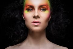 Attractive woman with colored make-up Stock Photos