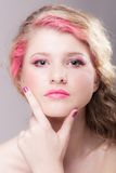Attractive woman with colorful makeup Stock Photography