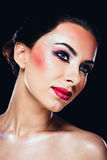 Attractive woman with colourful makeup Stock Photo