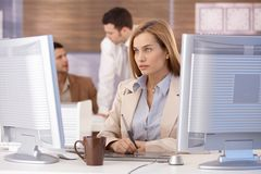 Attractive woman at computer training course Royalty Free Stock Image