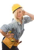 Attractive woman contractor  tools. Pretty middle age woman contractor or builder with tools tool belt and protective hard hat helmet Stock Photography