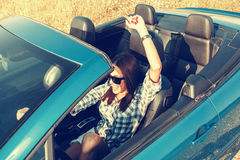 Attractive woman in a convertible car Stock Image