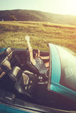 Attractive woman in a convertible car Royalty Free Stock Photography