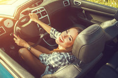 Attractive woman in a convertible car Royalty Free Stock Images