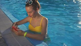 Attractive woman corresponding with friends on a mobile phone on a sunny day stock video